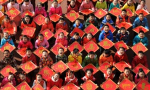Young Chinese students show their paper-cuts with the Chinese character, Ma, meaning Horse in English, to celebrate the Year of Horse in China's lunar calendar.