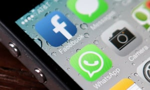 The Facebook and WhatsApp app icons are displayed on an iPhone.