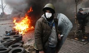 Anti-government protesters man a barricade in central Kiev, Ukraine, Thursday, Feb. 20, 2014
