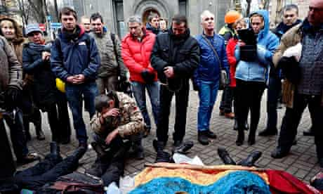 Activists pay respects to protesters killed in clashes with police in Kiev