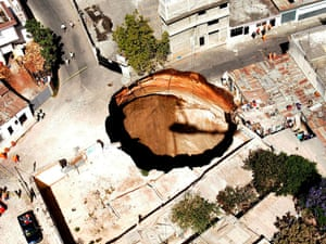 A giant sinkhole, 150 metres deep and 20 metres wide, in the neighbourhood of San Antonio in Guatemala City in February 2007, The sink hole swallowed close to twenty homes and left three people missing.