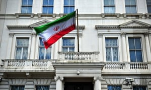 The Iranian flag hangs outside the Iranian embassy