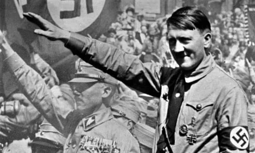 A picture of Adolf Hitler (1889-1945), the German fascist dictator, pictured saluting at a Nuremberg rally, 1934.  (Photo by Popperfoto/Getty Images) Famous Swastika Nazi Heil