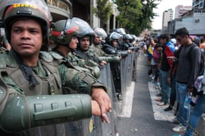 Opposition supporters line up in front of the security forces in a stand off outside the Justice Palace in Caracas.