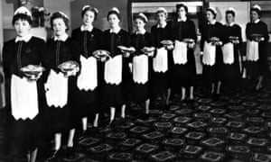 Black and white photo of 1950s waitresses.
