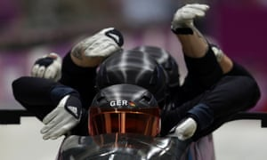 The team from Germany GER-1, piloted by Maximilian Arndt, start a run during the men's four-man bobsled training at the 2014 Winter Olympics.