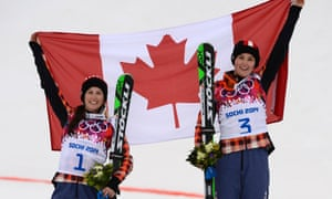Canada's second-placed Kelsey Serwa, left, and winner Marielle Thompson celebrate with the Canadian flag after the women's freestyle skiing ski cross final.