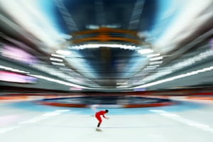 Mari Hemmer of Norway and Anna Chernova of Russia compete during the Women's 5000m speed skating event.