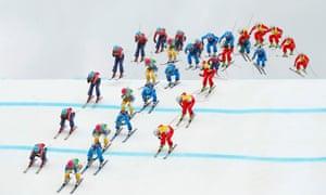 Sweden's Anna Holmlund, in the green bib, Canada's Kelsey Serwa (red bib), Austria's Katrin Ofner (blue bib) and Switzerland's Fanny Smith (yellow bib) in the women's freestyle skiing ski cross semi-finals.