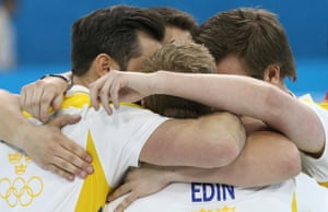 Team Sweden celebrate victory in the Bronze medal match against China in the Men's Curling.