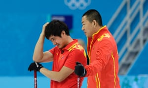 China's Xu Xiaoming, left, and skip Liu Rui, right, during the men's curling bronze medal game against Sweden.