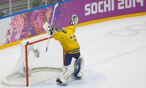 Sweden goaltender Henrik Lundqvist reacts to Sweden's 2-1 victory over Finland in the men's semifinal ice hockey game.