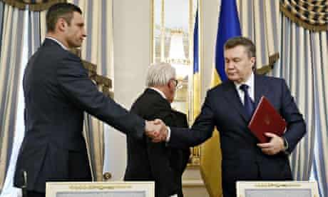 Vitali Klitschko and Viktor Yanukovych shake hands