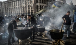People cook for protesters on Independence square.