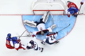 Jonathan Quick of the United States makes an unorthodox save against Czech Republic.