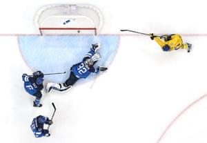 Loui Eriksson of Sweden scores a second-period goal against Kari Lehtonen of Finland.