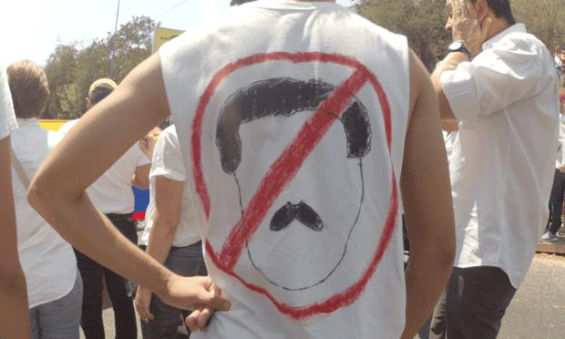 Protester wears 'no more Maduro' shirt in Valencia, Venezuela