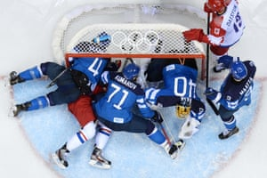 Russia's Alexander Radulov (second left) is squashed as he tries to score against Finland.