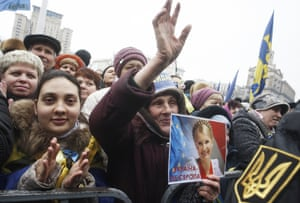 A woman holds a portrait of Yulia Tymoshenko at a rally in Kyiv's Independence Square.