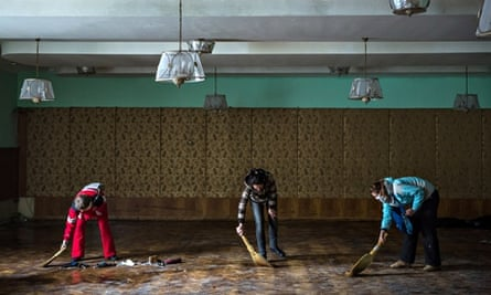 Women clean inside the partially burned Trade Unions Building