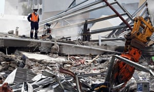 Rescue workers work on remains in Christchurch, New Zealand