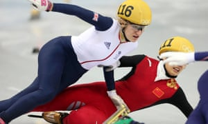 Great Britain's Elise Christie is impeded by China's Li Jianrou as she crashes in her1000m Short Track Semi Final.