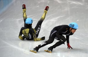 Japan's Satoshi Sakashita is upturned as he competes in the Men's Short Track 500 m Quarterfinals.