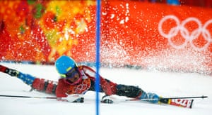 Iran's Forough Abbasi crashes during the first run of the women's alpine skiing slalom event.