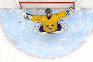 Henrik Lundqvist of Sweden celebrates after defeating Finland 2-1 during the Men's Ice Hockey Semifinal Playoff.
