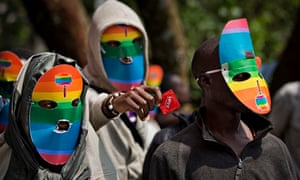 Kenyans wear masks to preserve their anonymity while staging a rare protest last month against Ugand