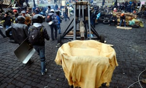 Protesters pass by a catapult in central Kiev,