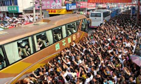 a crowd in Anhui province waves off a coachload of students on their way to the nine-hour 'gaokao'