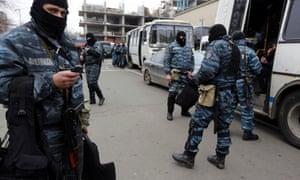 Member of Berkut anti-riot unit prepare to leave their barracks in Kiev.