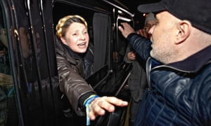 Ukrainian opposition leader Yulia Tymoshenko greets supporters from a car as she leaves the Central Clinical Hospital in Kharkiv, where she was being held under guard.