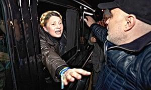 Yulia Tymoshenko stretches arm out to greet supporters