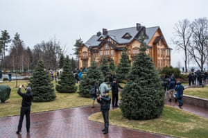 People wander through the maze of conifer trees in the garden.
