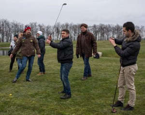 FOUR!, Visitors play a round of golf on the President's private golf course.