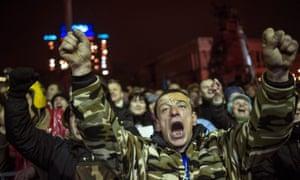 An Ukrainian man cheers as he listens to the speech of the former Ukrainian Prime Minister Yulia Tymoshenko.