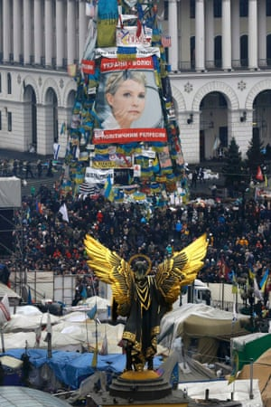 Protesters gathered near a poster of freed opposition leader Yulia Tymoshenko in the Independence Square in Kiev.