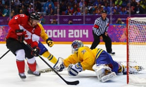 Canada's Sidney Crosby dekes Sweden's goalie Henrik Lundqvist then scores during the second period of the men's ice hockey gold medal game at the 2014 Sochi Winter Olympic Games.