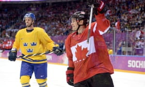 Niklas Hjalmarsson of Sweden reacts as Chris Kunitz of Canada celebrates after scoring a third-period goal during the Men's Ice Hockey Gold Medal match at the 2014 Sochi Winter Olympics  in Sochi, Russia.