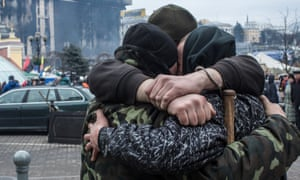 A group of anti-government protesters share a hug on Independence Square