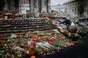 People lay flowers for anti-government demonstrators