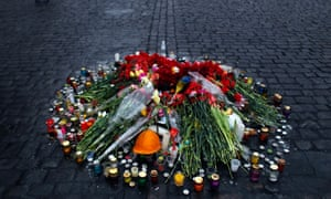 A floral tribute to people killed in clashes with the police stands on a street in Kiev.