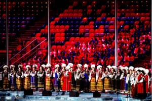 Actors dressed in Kosack's attire perform during the Closing Ceremony of the Sochi 2014 Winter Olympics