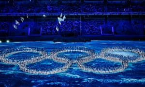 Performers create the Olympic rings during the closing ceremony of the 2014 Winter Olympic
