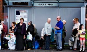 Shoppers queue for the bus on Duke Street in Glasgow
