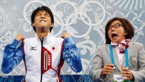 "Japan's Yuzuru Hanyu reacts with his figure skating coach Yoshiko Kobayashi in the ""kiss and cry"" area during the figure skating men's short program."