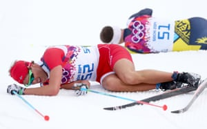 Chris Andre Jespersen of Norway and Alexey Poltoranin of Kazakhstan collapse on the snow after competing in the men's 15km classic.