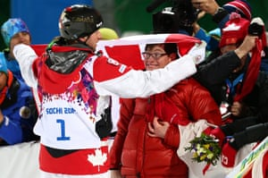 Gold medalist Alex Bilodeau of Canada celebrates with his brother Frederic, who has cerebral palsy, after the flower ceremony for the men's moguls finals.